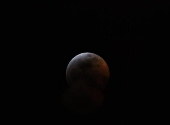 The lunar eclipse is seen in Colorado on Jan. 20.