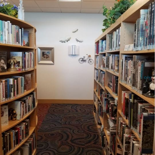 In expanding the Fort Myers Beach library, its director, Leroy Hommerding made sure that artwork, on the walls, in display cases and even used as bookends, was prominently featured.