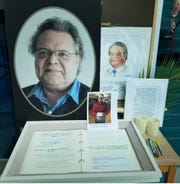 Photographs and a picture of slain Fort Myers Beach Public Library director Leroy Hommerding greeted visitors Tuesday when the building opened to the public for the first time since Hommerding was killed Sunday.