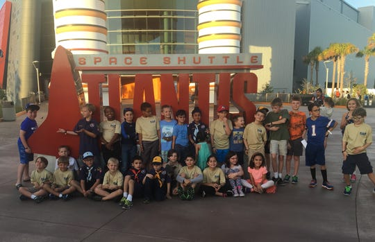 Zane LeBoutillier and Julian Ellis Jr., top row, second and third from left, with their Cub Scout pack at The Kennedy Space Center. Many off the children, including Zane and Julian, were classmates at Allen Park Elementary School in Fort Myers.