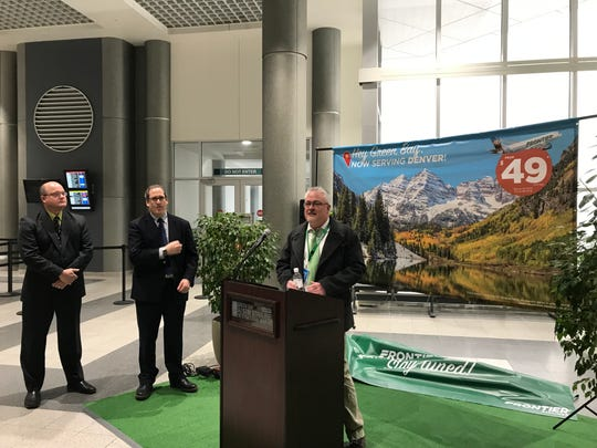 Will Evans, right, of Frontier Airlines, on Jan. 22 announced the ultra-low-cost carrier will begin offering nonstop flights between Denver and Green Bay on May 23. To the left, Airport Director Marty Piette and County Executive Troy Streckenbach look on.