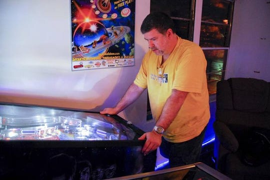 Patrick Peitras, a founding member of the Palmetto Pinball Club, shows off some of his pinball wizardry. Peitras will be a competitor in the upcoming tournament.