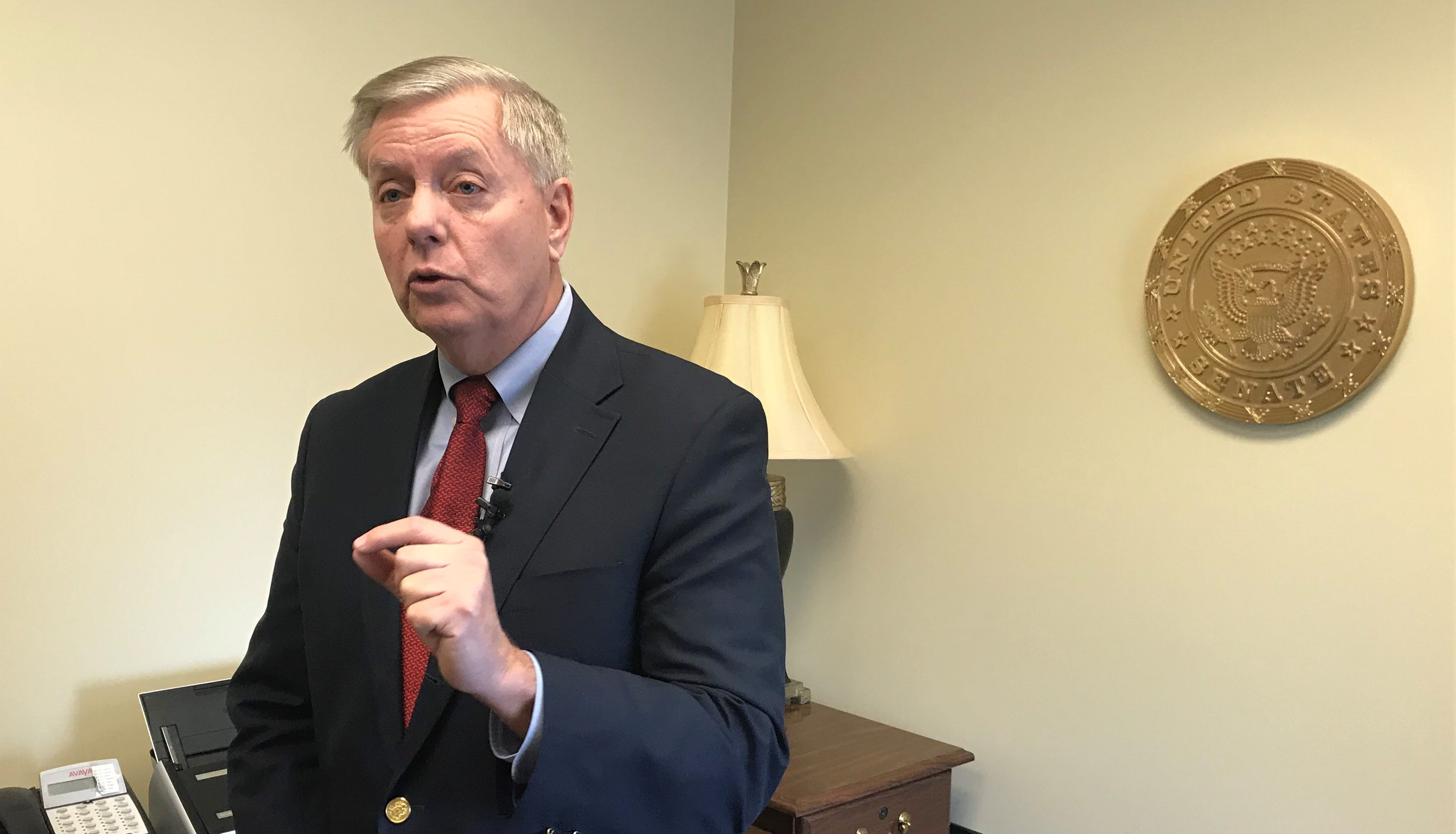 U.S. Sen. Lindsey Graham speaks to the media in Greenville on Tuesday about his proposal to end the federal government's partial shutdown.
