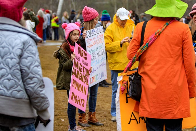 People filled a part of Falls Park on the Reedy River for The Women's March in Greenville on Jan. 19, 2019.