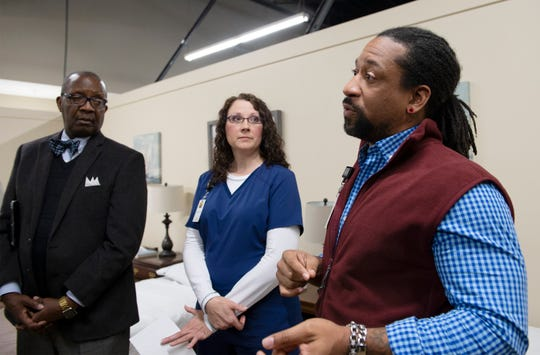 From left, Kenneth Baxter, from the board of directors for New Horizon Family Health Services, and Kendal Seymore listen as Brandon Cook, program manager the Health Care for the Homeless Program at New Horizon Family Health Services, answer questions in January about the new medical respite program at Miracle Hill's Greenville Rescue Mission Tuesday, Jan. 22, 2019. Seymore is the medical respite nurse at the facility.