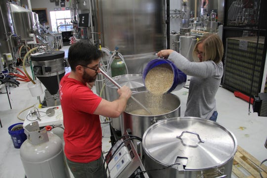 Brewery 85 brewmaster, Thomas Westmoreland and co-owner, Meredith McCameron, during the brewing process.