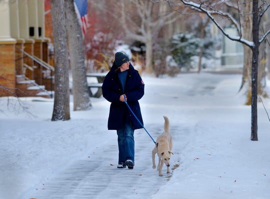 Tami Thompson walks with Rocket on Tuesday morning after Great Falls received 5.5 inches of new snow on Sunday and Monday.