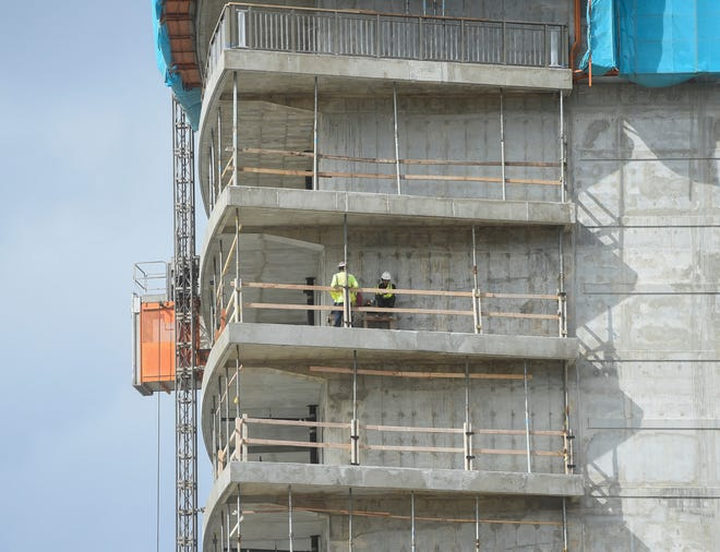Construction workers on the site of the Tsubaki Tower hotel project in Tumon, Jan. 22, 2019. The decrease in Guam's GDP is attributed, in part, to decreased spending on construction by the government of Guam and the private sector.