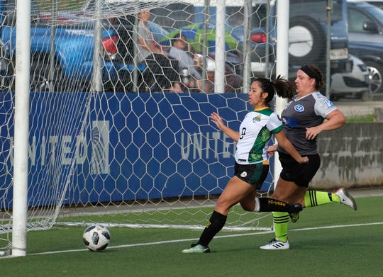 Ariya Cruz scores for Lady Tritons. UOG defeated the Lady Bombers 6-0 in the Guam Football Association Amateur Women's League Sunday at the GFA National Training Center.
