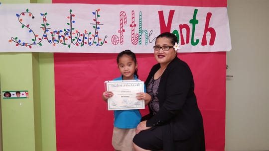 Guahan Academy Charter School's November Student of the Month awardee, Ellena Rokop on Dec. 13.  Pictured: Eleen Mori and Rokop.