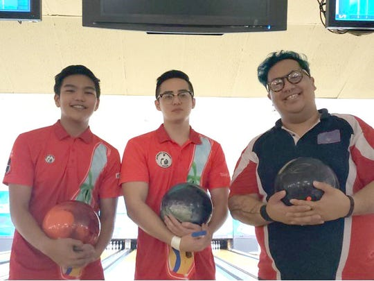 """Guam National Bowling Championship winner Nikko Gutierrez, center, with Jeremiah Camacho, left, second-place winner, and third-place finisher Charlie """"Mama Char"""" Catbagan."""