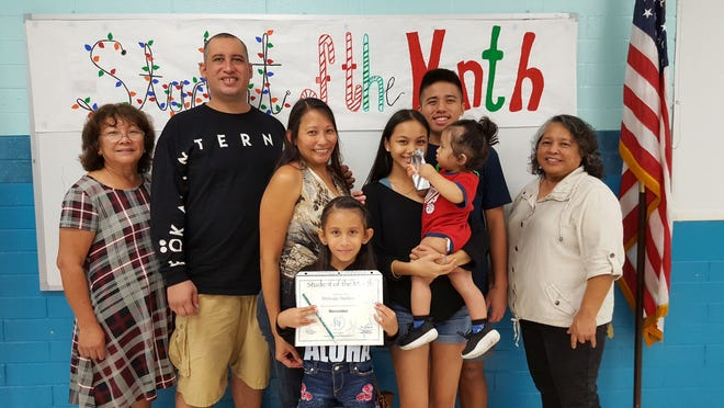 The Guahan Academy Charter School honored its November Student of the Month awardees on Dec. 13, 2018. Pictured: Mishayla Mathews, Teresita Cruz, Dean of High School, Guahan Academy Charter School; Bryan Mathews; Daphne Mathews; Mikaila Cuasito with Zayne Mathews; Joseph Tedtaotao and Mary Mafnas, Dean of Elementary School Guahan Academy Charter School.