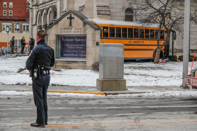 An M.S.D. of Washington Township Township School Bus collided with the Roberts Park Methodist Church at the corner of Delaware St. and Vermont St. in downtown Indianapolis on Tuesday, Jan. 22, 2019. The bus initially collided with a tow truck after allegedly running a red light, causing the bus to collide with the church and the tow truck to strike parked vehicles along Delaware St. The bus driver and others were transported by ambulance.