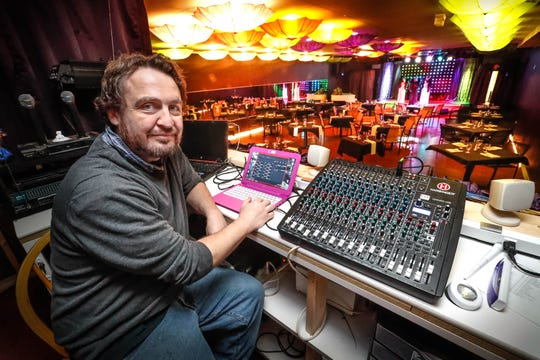 Chris Plunkett, director of technical services, sits at the helm in the sound and lighting booth at Stage to Screen Catered Cabaret Theatre, 350 S. Madison Ave. in Greenwood