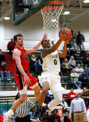 James Franklin (0) goes up for a layup in Cathedral's win over Cardinal Ritter in the City tournament semifinals at Tech on Monday.