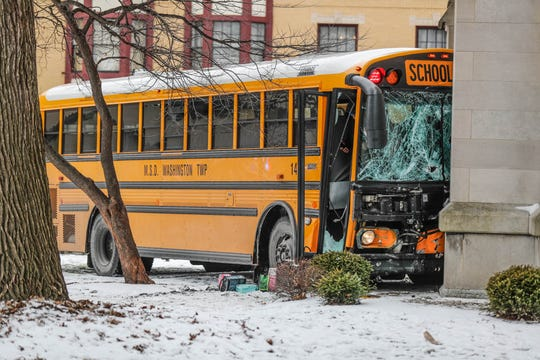 A school bus crashed into Roberts Park Methodist Church after a collision with a tow truck at the corner of Delaware and Vermont streets in downtown Indianapolis on Jan. 22, 2019.