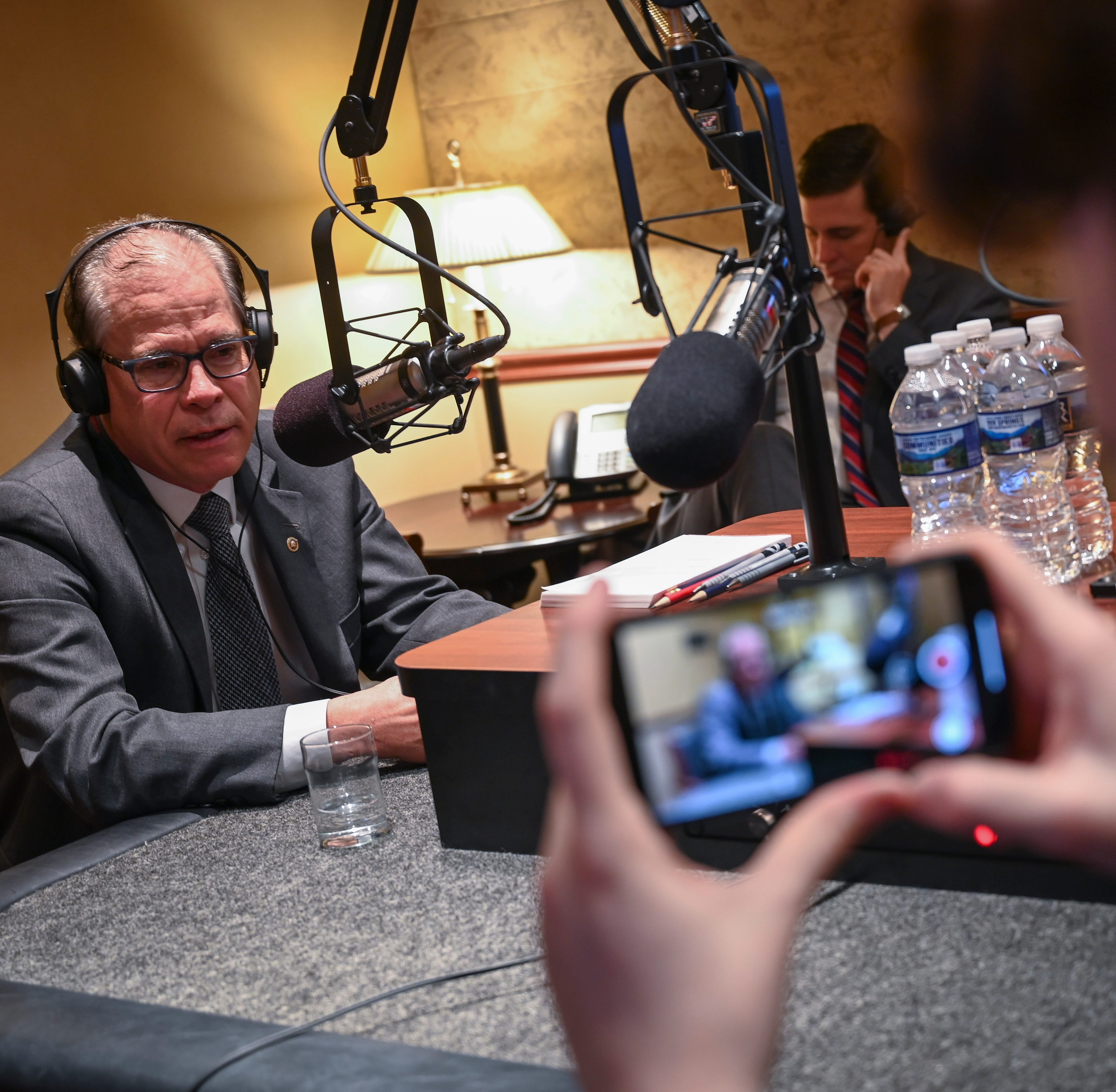 Senator Mike Braun, R-Indiana, on the radio live during early morning radio calls speaking to WOWO South Bend and also with Indianapolis WIBC's Tony Katz from the Senate Recording Studios with Braun's chief of staff Josh Kelley listening on headphones while Zach Riddle, Braun's deputy communication director records the conversations.