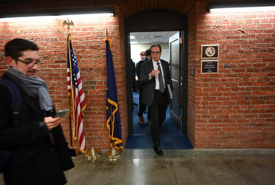 Senator Mike Braun, R-Indiana, departs his Russell Senate Office Building basement office walking to a United States Senate Special Committee on Aging hearing held on the fifth floor of Dirksen Senate office building examining the issue of elder fraud.