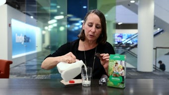 IndyStar's Liz Biro demonstrates how to turn a Thin Mint Girl Scout cookie into a straw to drink milk, beer or bourbon.