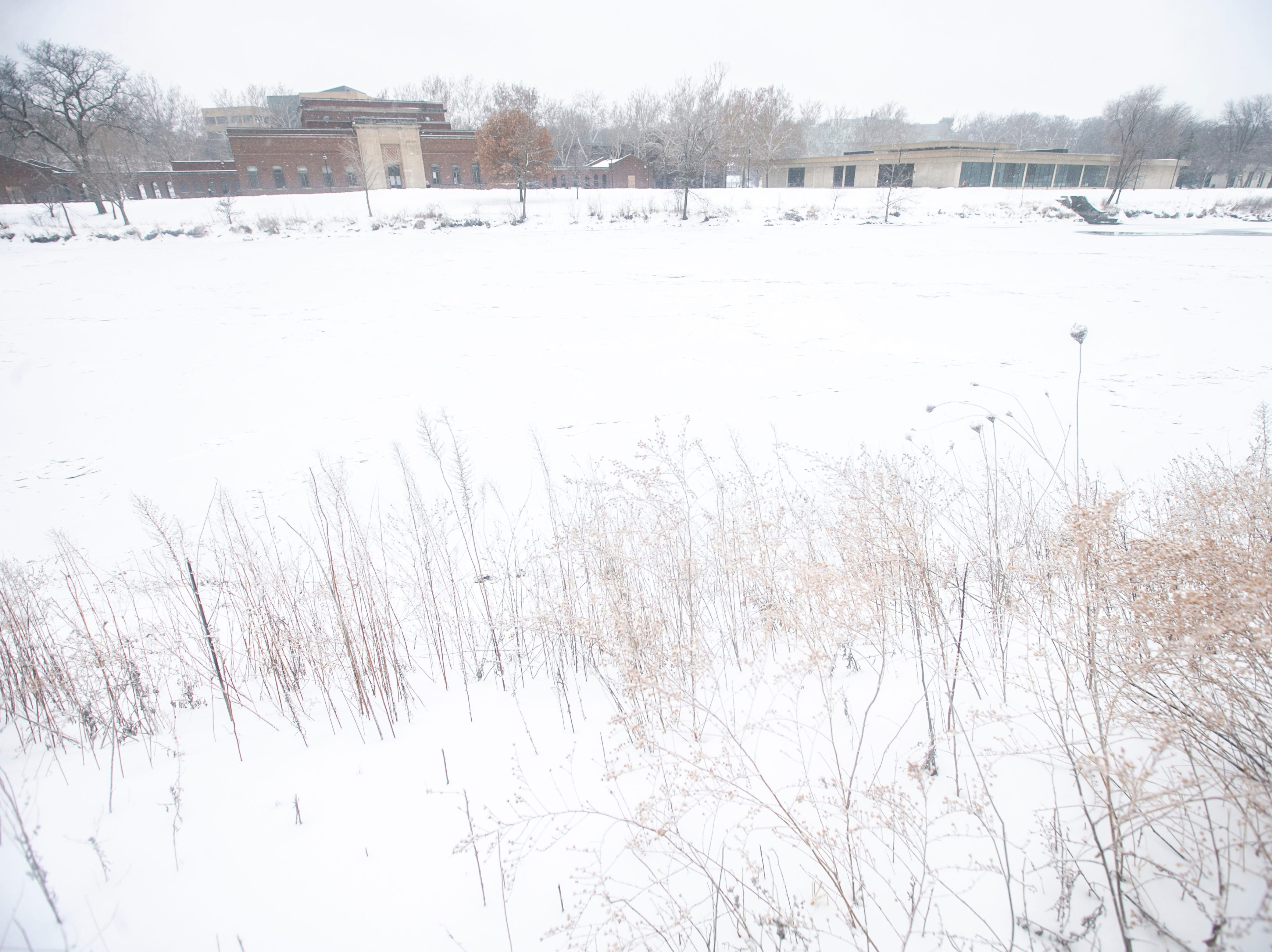 Snow blankets the partially frozen Iowa River on Tuesday, Jan. 22, 2019, in Iowa City, Iowa.