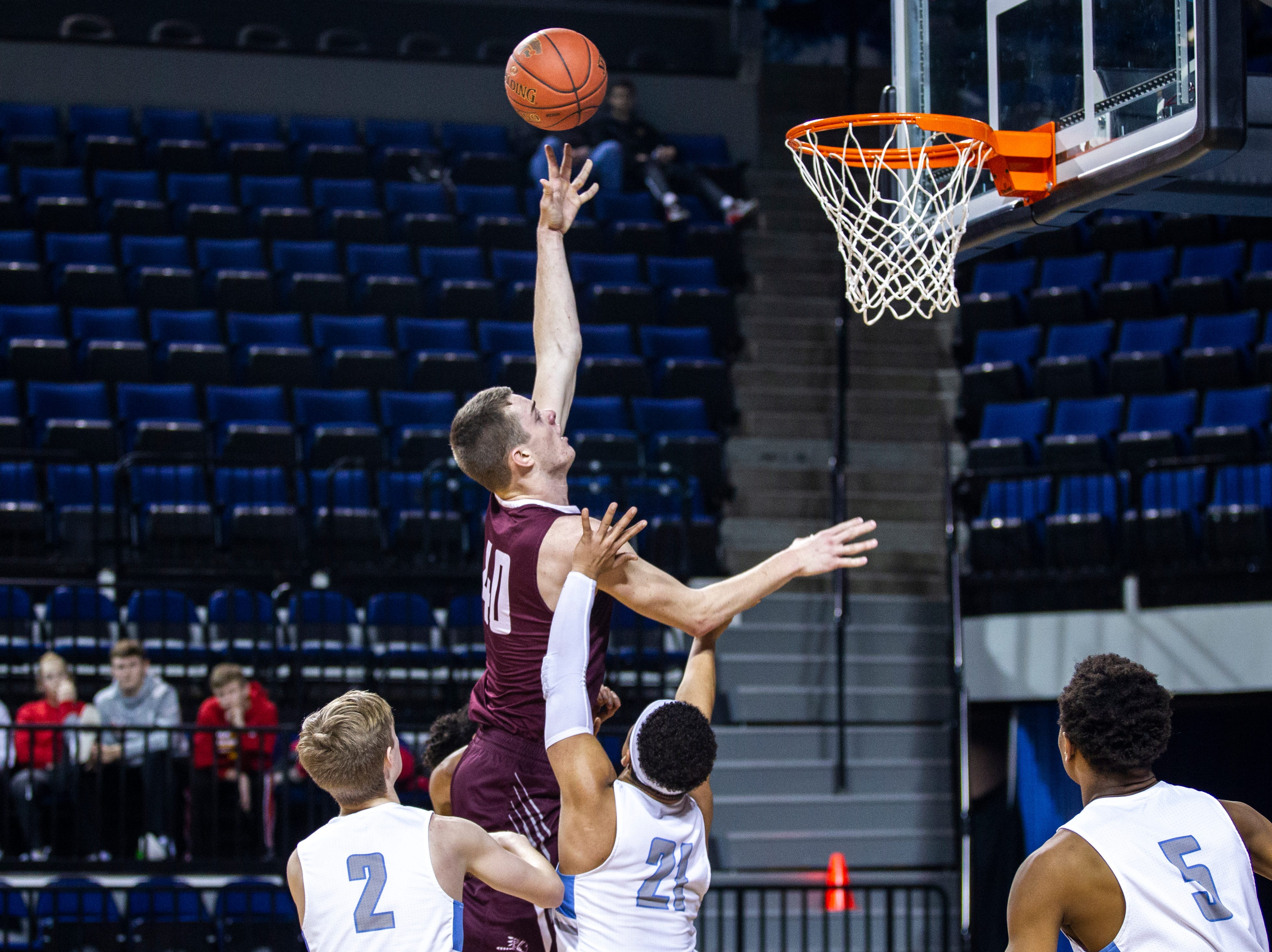 Oskaloosa's Cole Henry (40) attempts a basket during a boys' basketball game in the Wells Fargo Advisors Shootout on Saturday, Jan. 19, 2019, at the U.S. Cellular Center in Cedar Rapids, Iowa.