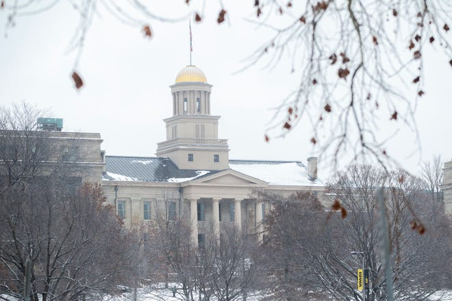 The Old Capitol Building is seen as light snow falls on Tuesday, Jan. 22, 2019, in Iowa City, Iowa.