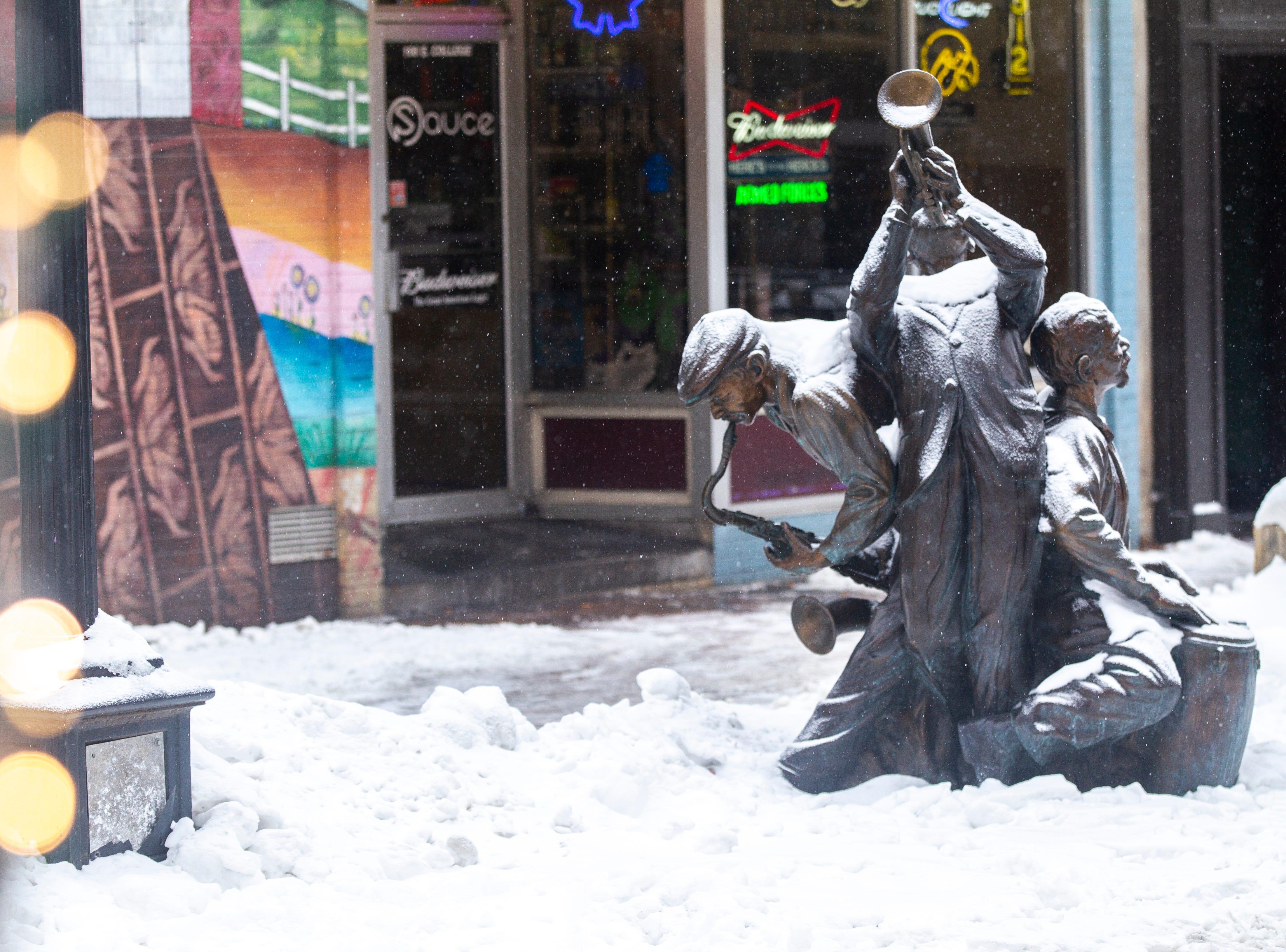 """Jazz"" is seen as light snow falls on Tuesday, Jan. 22, 2019, along the pedestrian mall in Iowa City, Iowa."