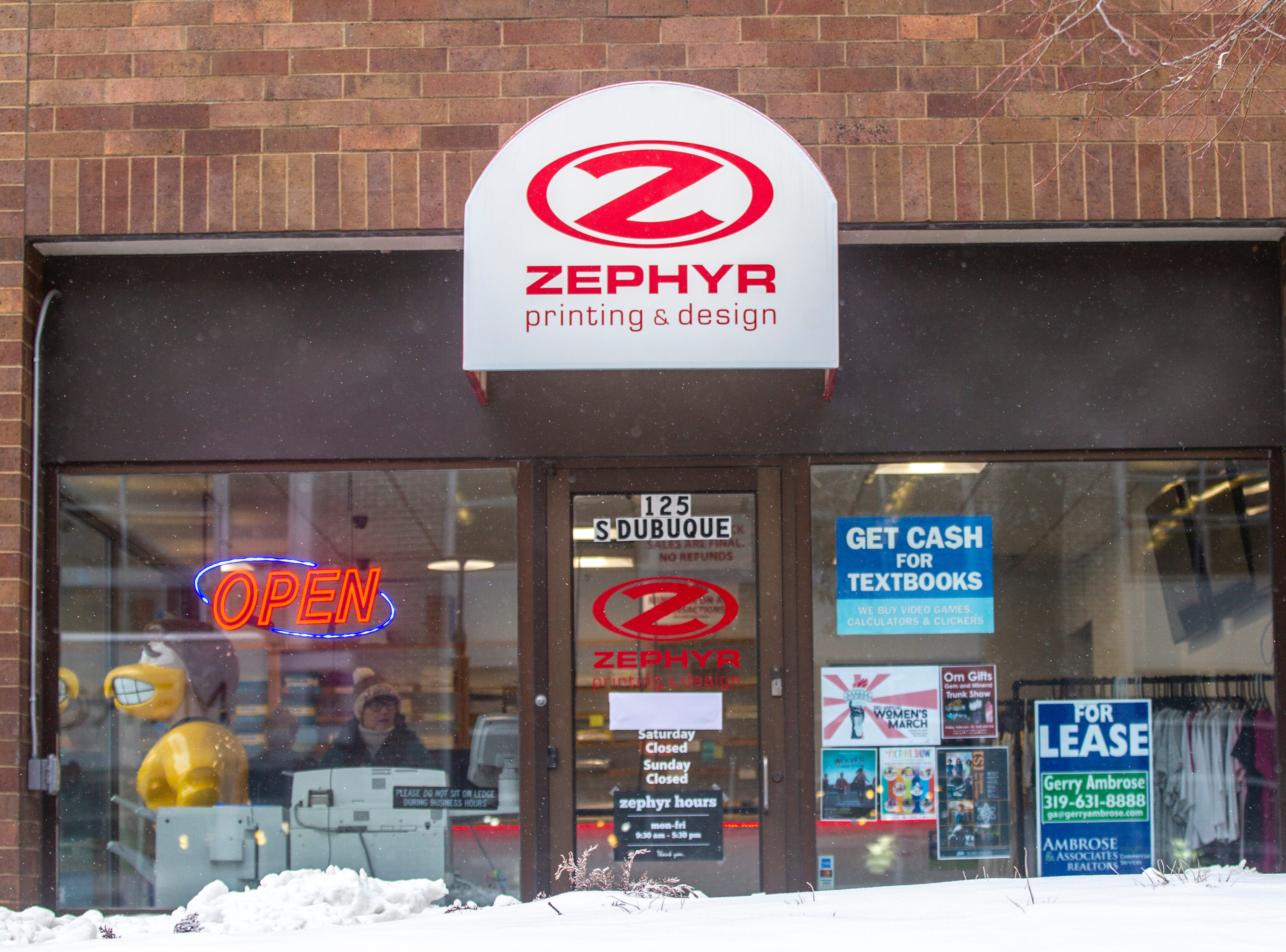 Zephyr Printing & Design is seen as light snow falls on Tuesday, Jan. 22, 2019, in Iowa City, Iowa.