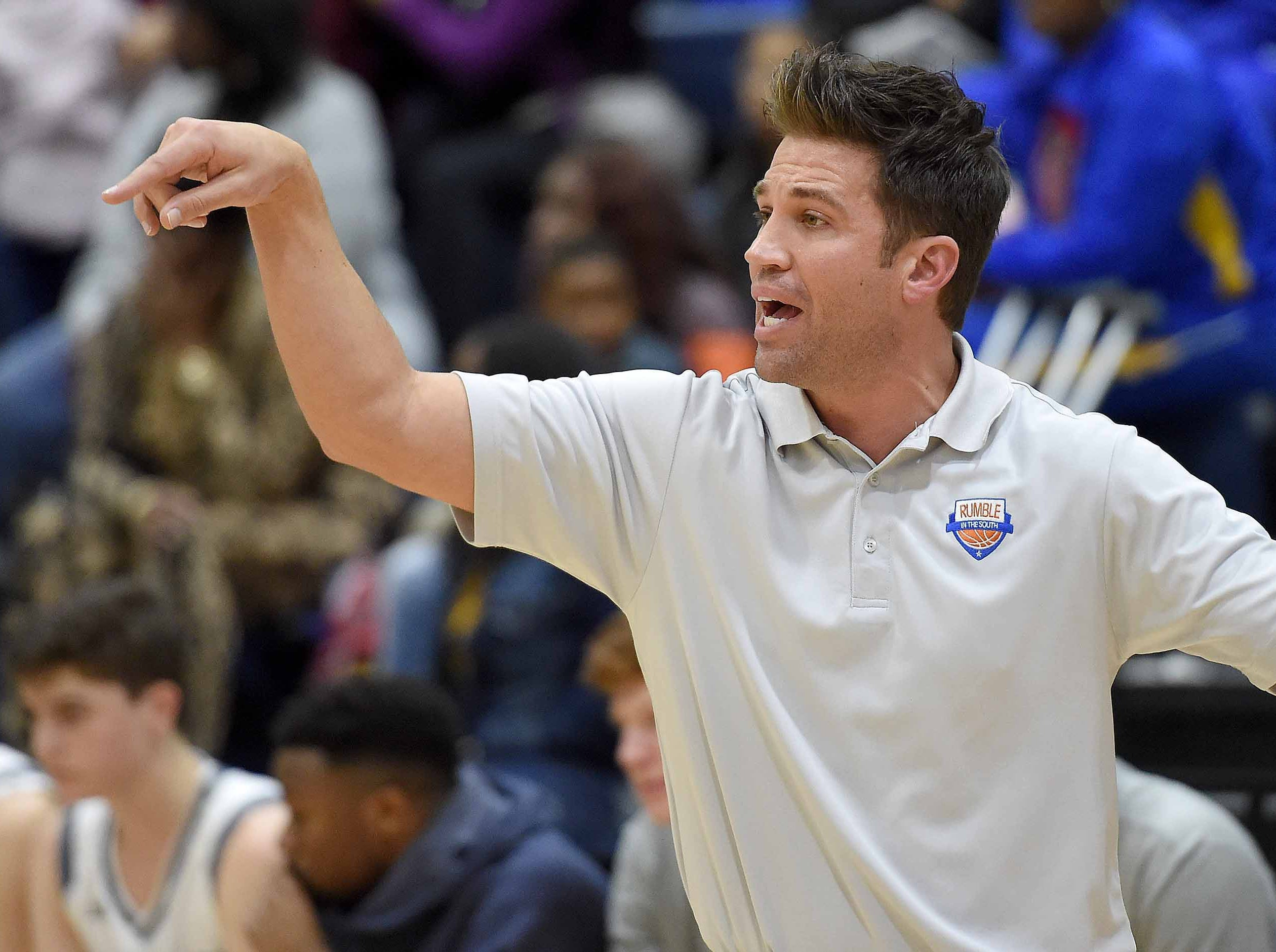 St. Andrew's head coach Brian Cronin calls out a play on Monday, January 21, 2019, at the Rumble in the South high school basketball tournament at St. Andrew's Episcopal School in Ridgeland, Miss.