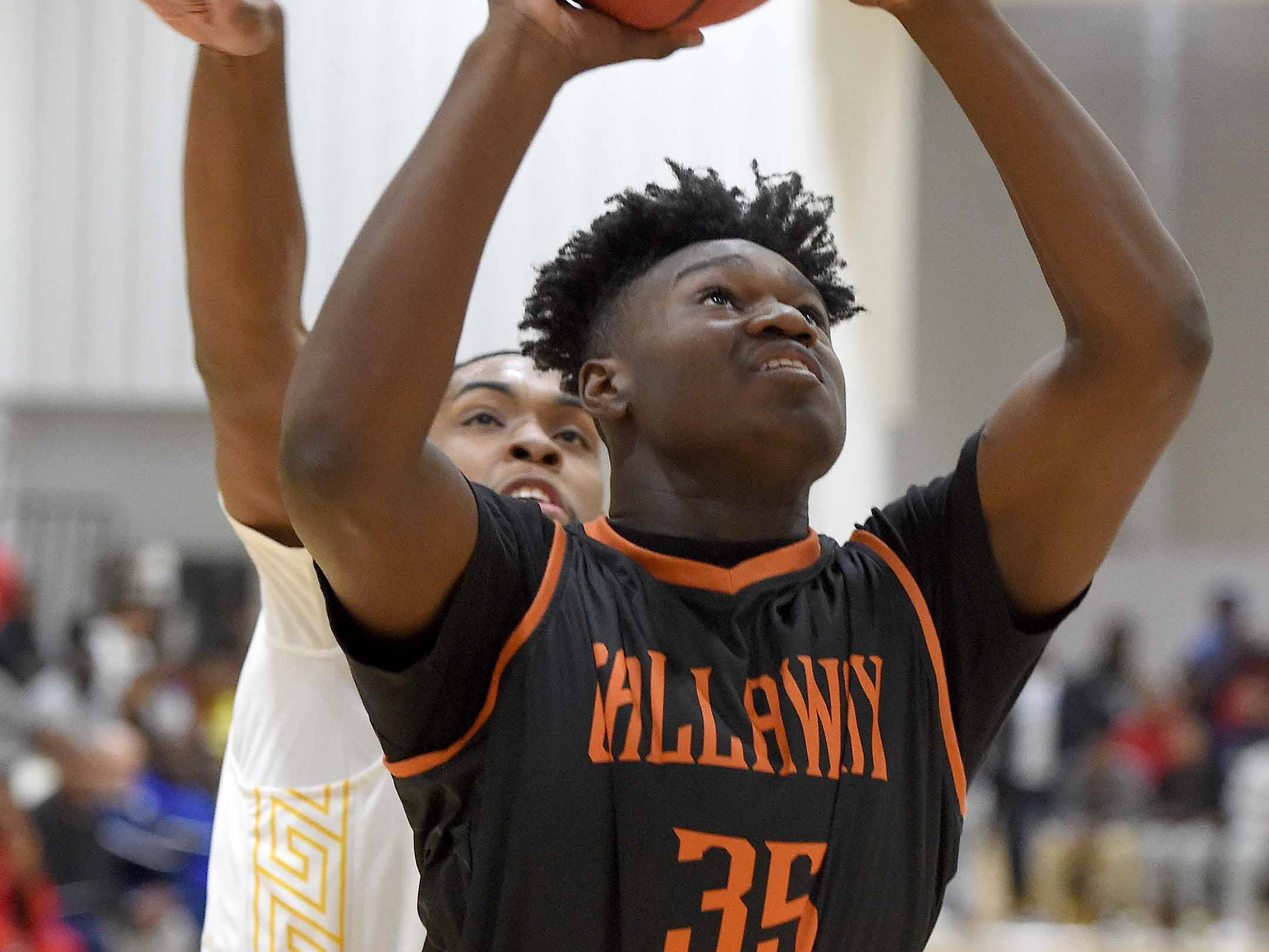 Callaway's Liquori Young (35) puts back a rebound against Raymond on Monday, January 21, 2019, at the Rumble in the South high school basketball tournament at St. Andrew's Episcopal School in Ridgeland, Miss.