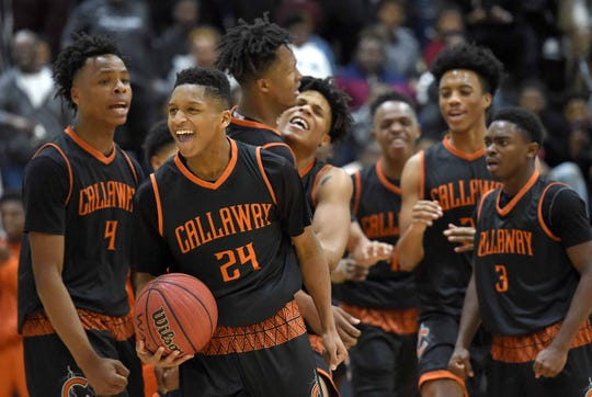 Daeshun Ruffin (24) and the Callaway Chargers celebrate their overtime win against Raymond on Monday, January 21, 2019, at the Rumble in the South high school basketball tournament at St. Andrew's Episcopal School in Ridgeland, Miss.