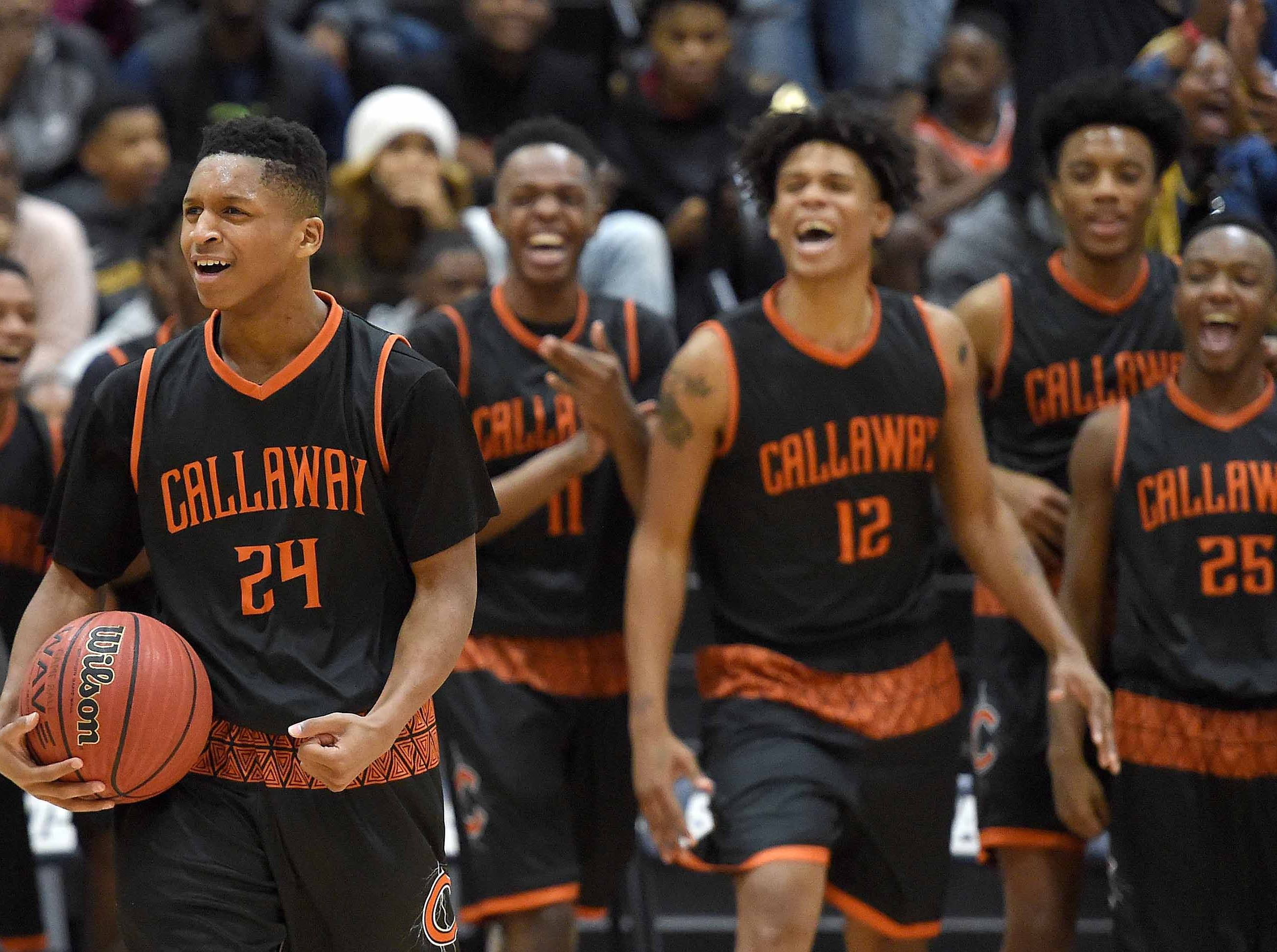 The Callaway Chargers celebrate their overtime win against Raymond on Monday, January 21, 2019, at the Rumble in the South high school basketball tournament at St. Andrew's Episcopal School in Ridgeland, Miss.