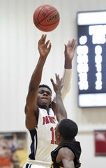 Forest Hill's Ken Evans Jr. (11) shoots over a Starkville defender on Monday, January 21, 2019, at the Rumble in the South high school basketball tournament at St. Andrew's Episcopal School in Ridgeland, Miss.
