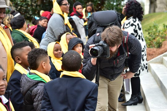 Photographer Ron Blaylock captures images of school children attending the National School Choice Week rally on the steps of the capitol building in Jackson, MS. Tuesday, Jan. 22, 2019.