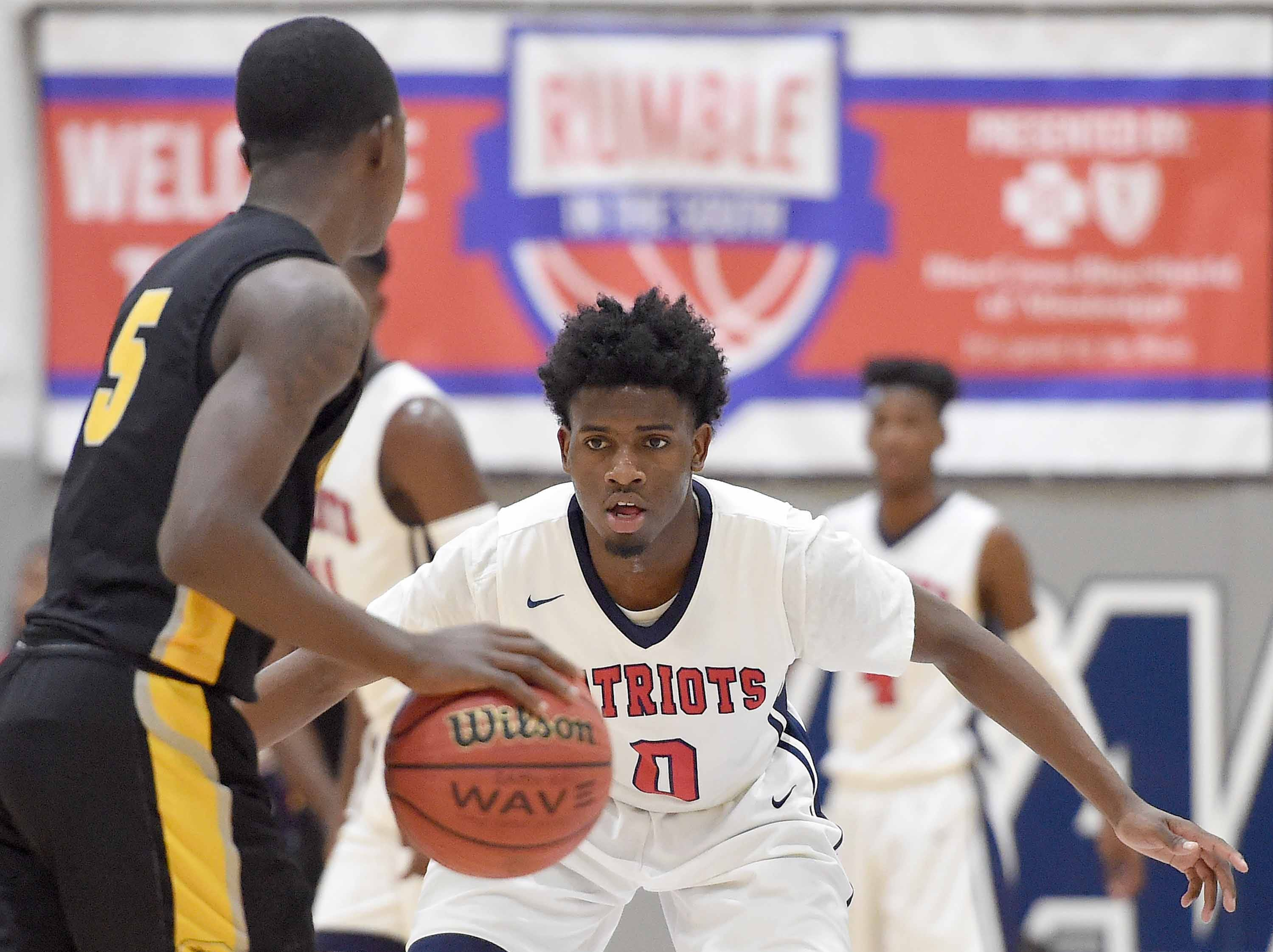 Forest Hill's Rodreekas Bush (0) defends Starkville's Forte Prater (5) on Monday, January 21, 2019, at the Rumble in the South high school basketball tournament at St. Andrew's Episcopal School in Ridgeland, Miss.