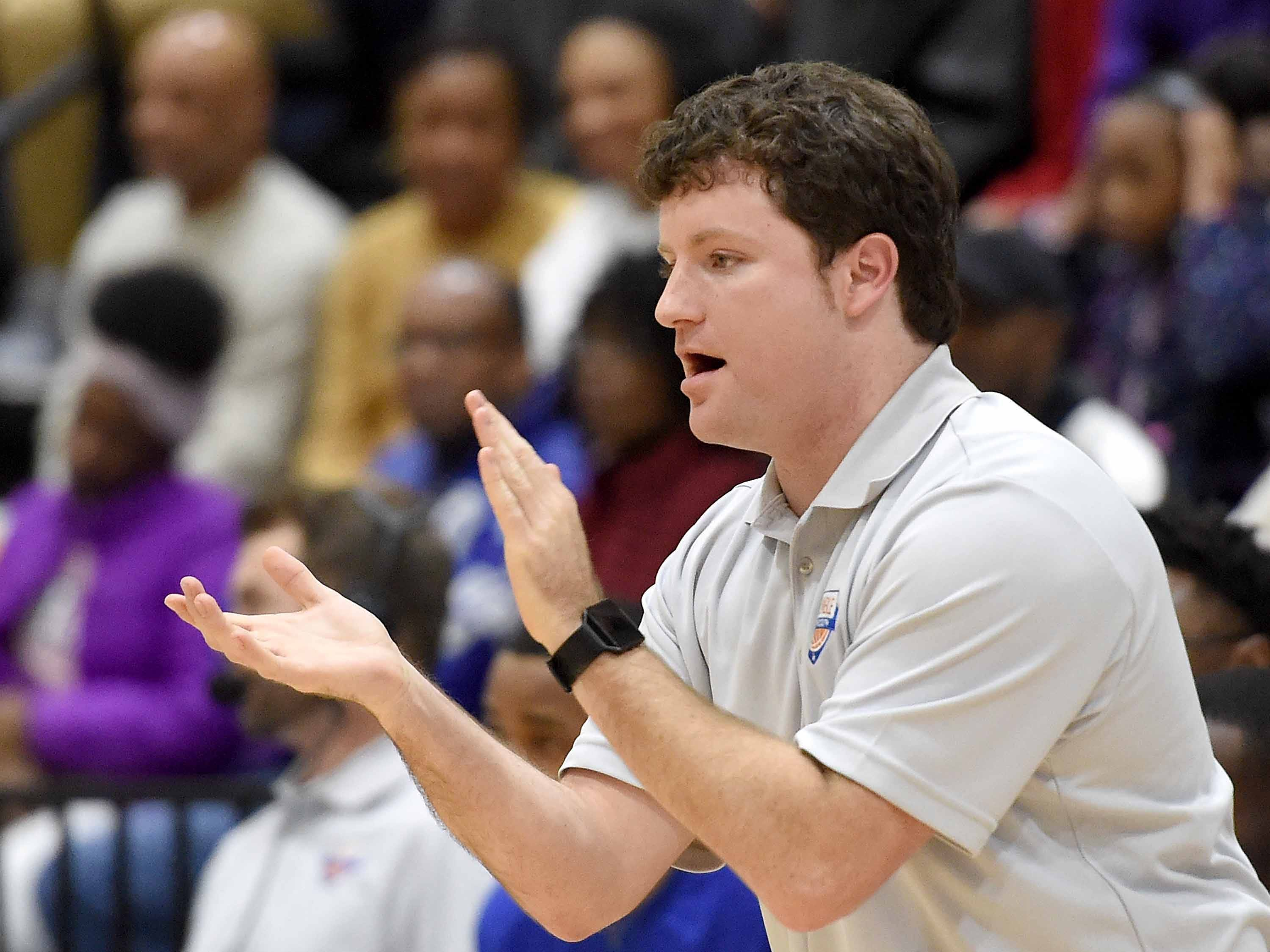Raymond head coach Tony Tadlock encourages his Rangers on Monday, January 21, 2019, at the Rumble in the South high school basketball tournament at St. Andrew's Episcopal School in Ridgeland, Miss.