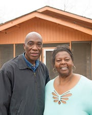 'The Boy with the Pop Bottle on his Head' filmmaker Steve Collins, left, poses with Marietha Catchings, right, outside Catchings' home in Hazlehurst. A survivor of the tornado, Catchings said everyone suffered in the aftermath of the natural disaster, but in the face of adversity, people helped one another. Monday, Jan.14, 2019.