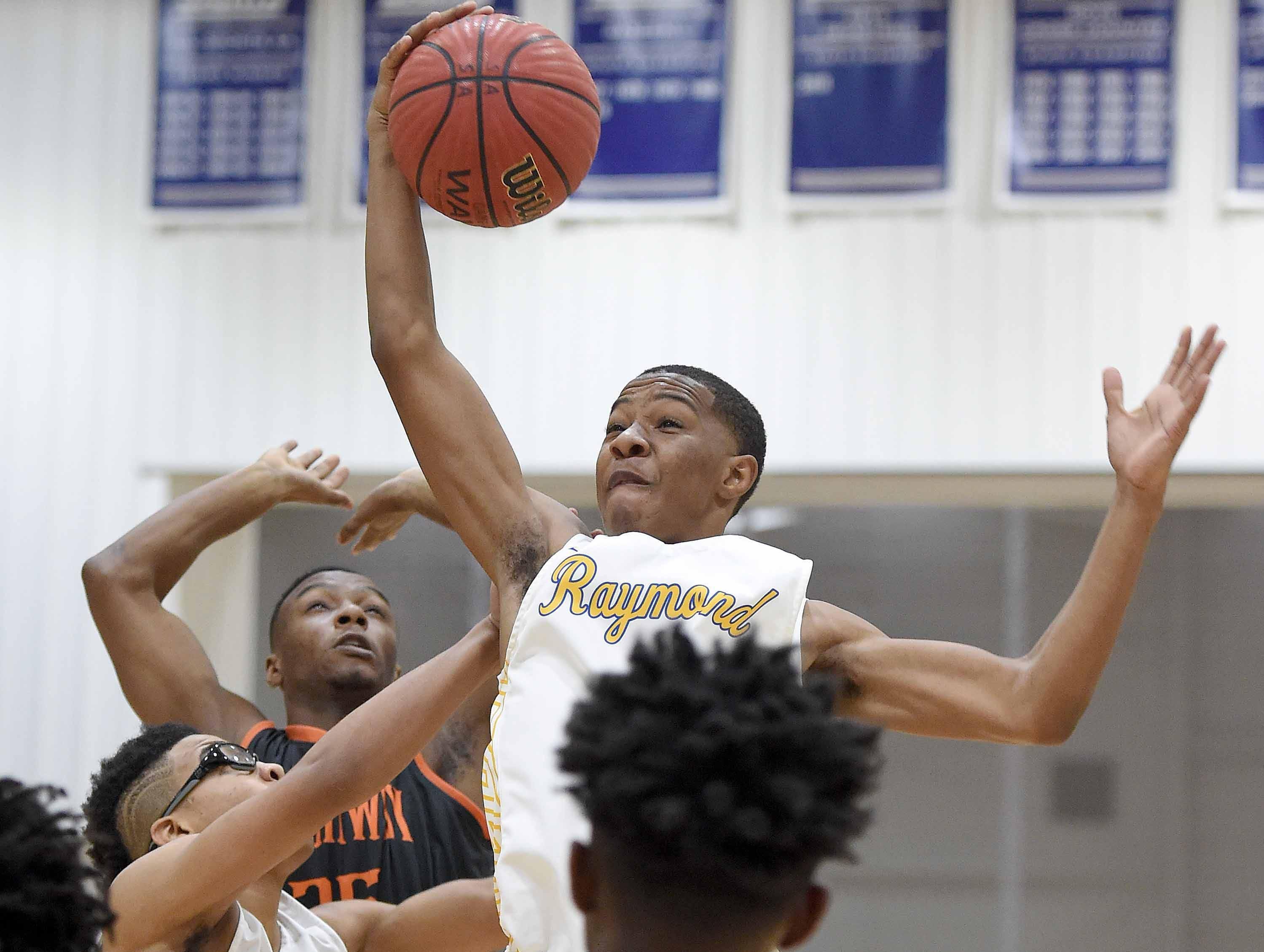 Raymond's Jordan Marshall (4) drives the lane against Callaway on Monday, January 21, 2019, at the Rumble in the South high school basketball tournament at St. Andrew's Episcopal School in Ridgeland, Miss.