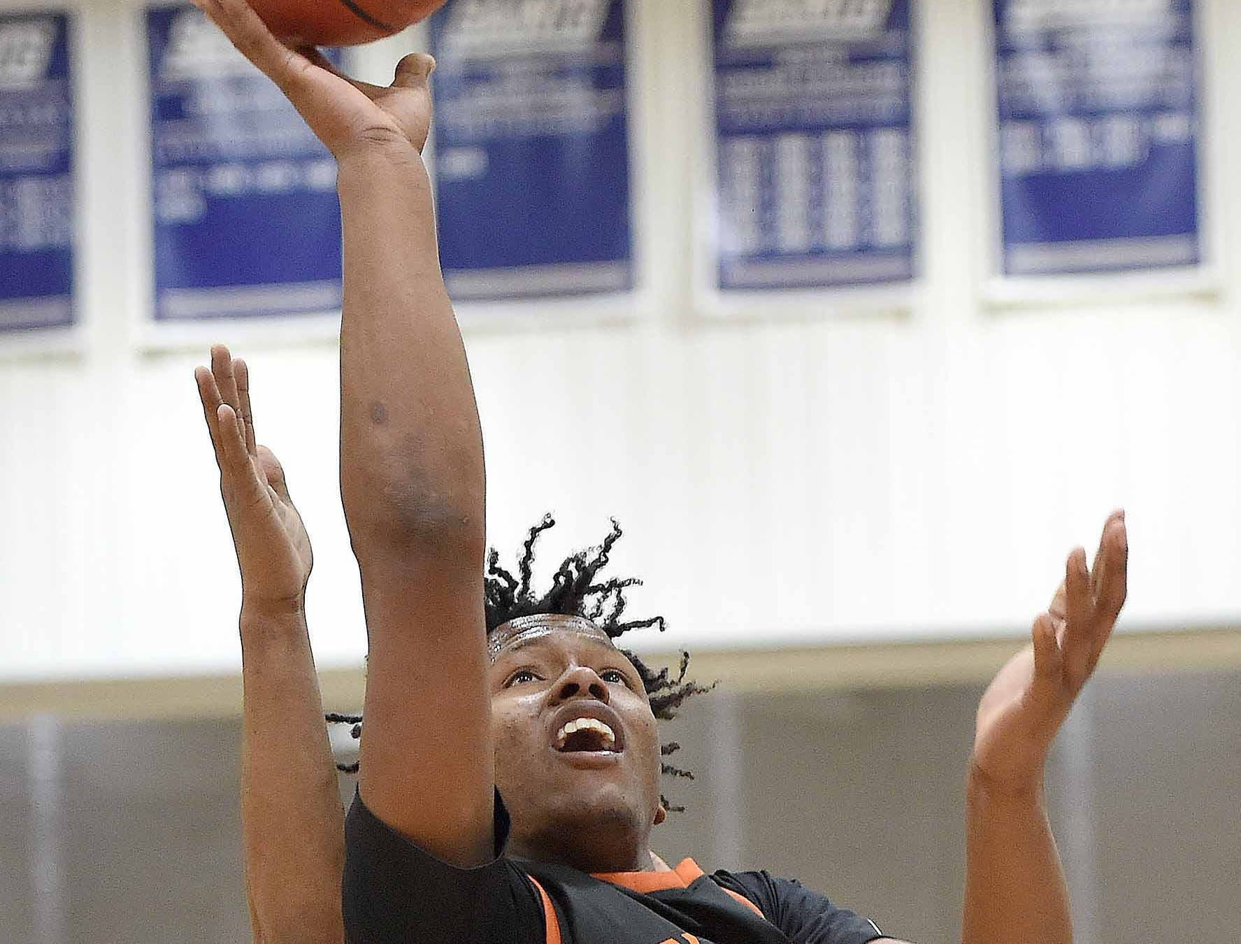 Callaway's Cuwandric Samuel (5) hits a layup against Raymond on Monday, January 21, 2019, at the Rumble in the South high school basketball tournament at St. Andrew's Episcopal School in Ridgeland, Miss.