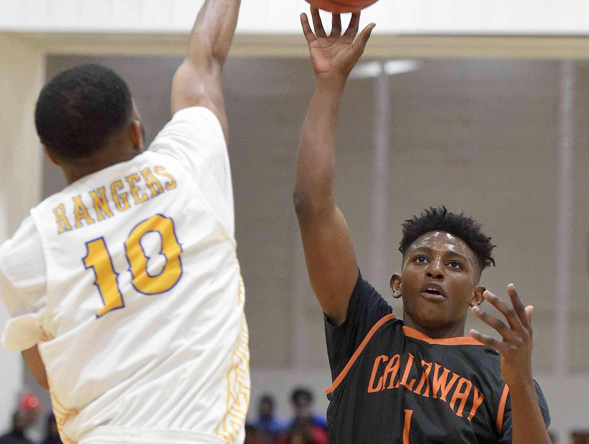 Callaway's Keiveon Hunt (1) puts up a one-handed shot in the lane against Raymond's Kenjuan Davis (10) on Monday, January 21, 2019, at the Rumble in the South high school basketball tournament at St. Andrew's Episcopal School in Ridgeland, Miss.