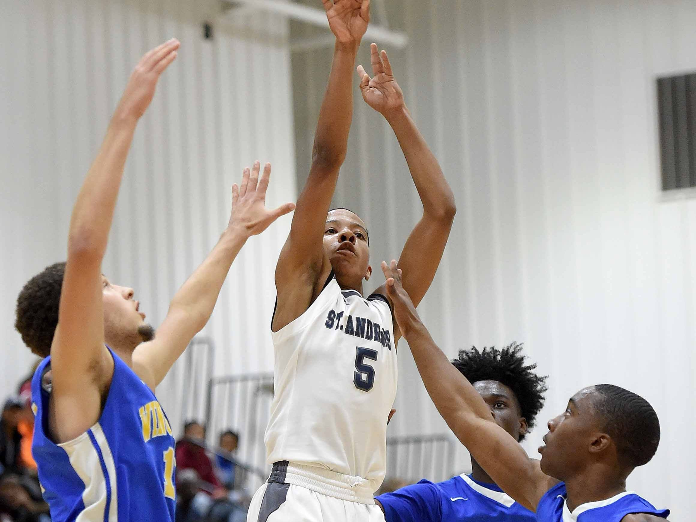 St. Andrew's Rashad Bolden (5) shoots in the middle of a trio of Wingfield defenders on Monday, January 21, 2019, at the Rumble in the South high school basketball tournament at St. Andrew's Episcopal School in Ridgeland, Miss.