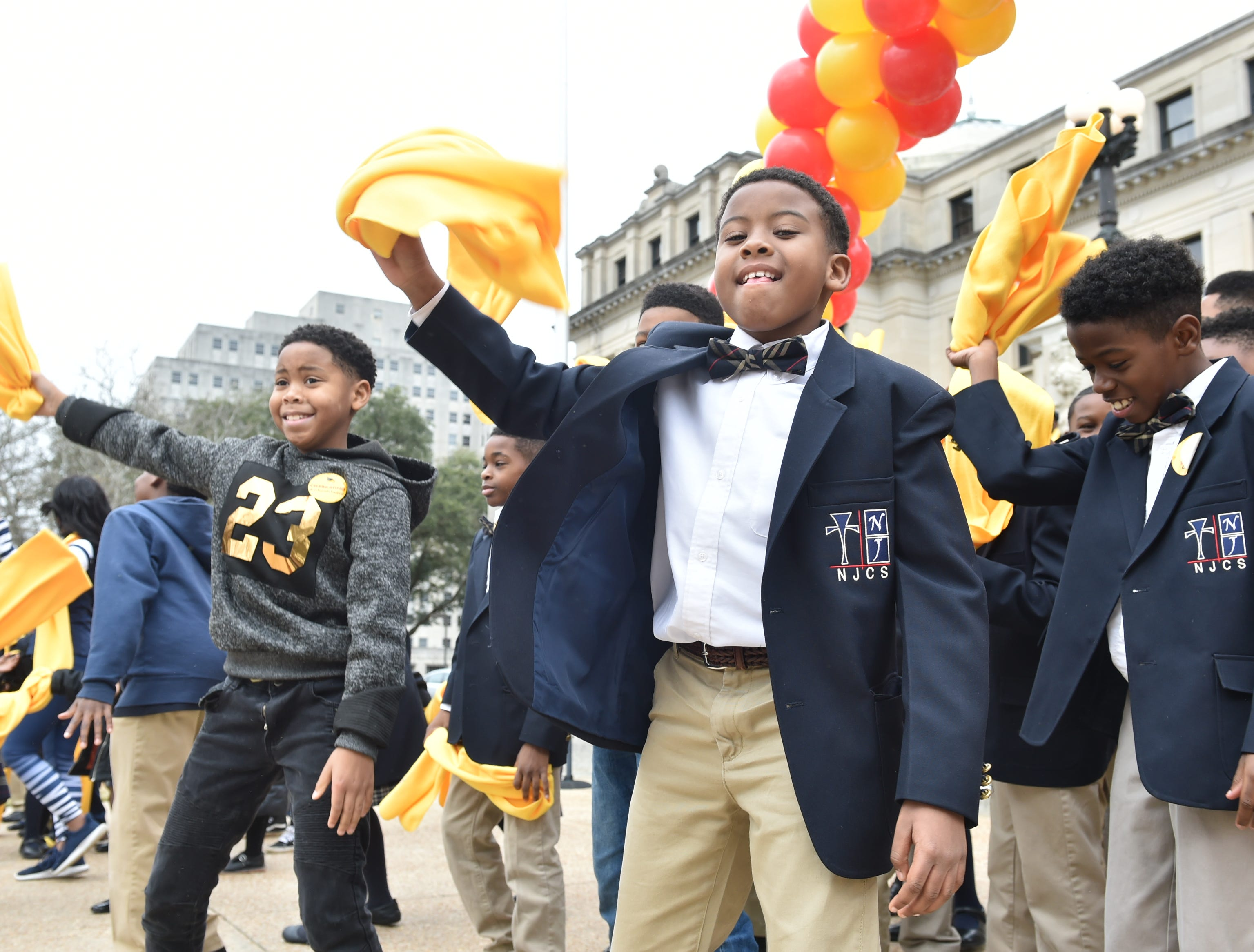 Students dance at a National School Choice Week rally held on the steps of the capitol building in Jackson, MS. Students from across the state attended the rally and met with legislators regarding school choice in Mississippi. Tuesday, Jan. 22, 2019.