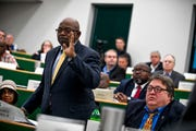 Claudell Brown stands to make a point at a Madison County Commission meeting at West Tennessee AgResearch and Education Center in Jackson, Tenn., on Tuesday, Jan. 22, 2019.