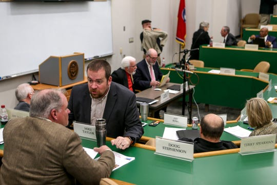 Jason Compton speaks with Mike Taylor after the conclusion of a Madison County Commission meeting at West Tennessee AgResearch and Education Center in Jackson, Tenn., on Tuesday, Jan. 22, 2019.
