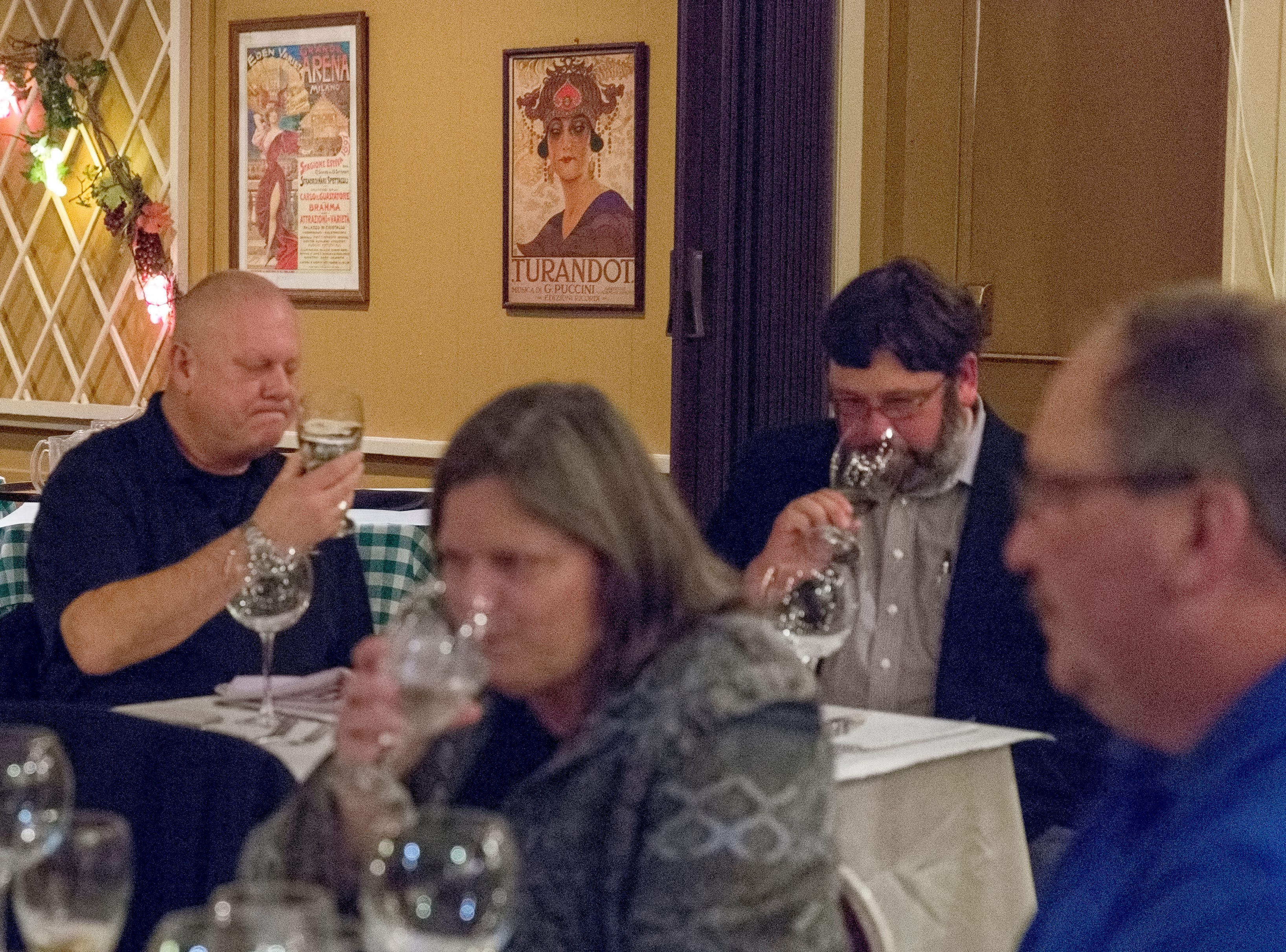 Alan Johns, owner of Party Mart, and David Boggan, Athens Artisan Selections, join in the last wine tasting at Baudo's Thursday night, january 17, 2019.