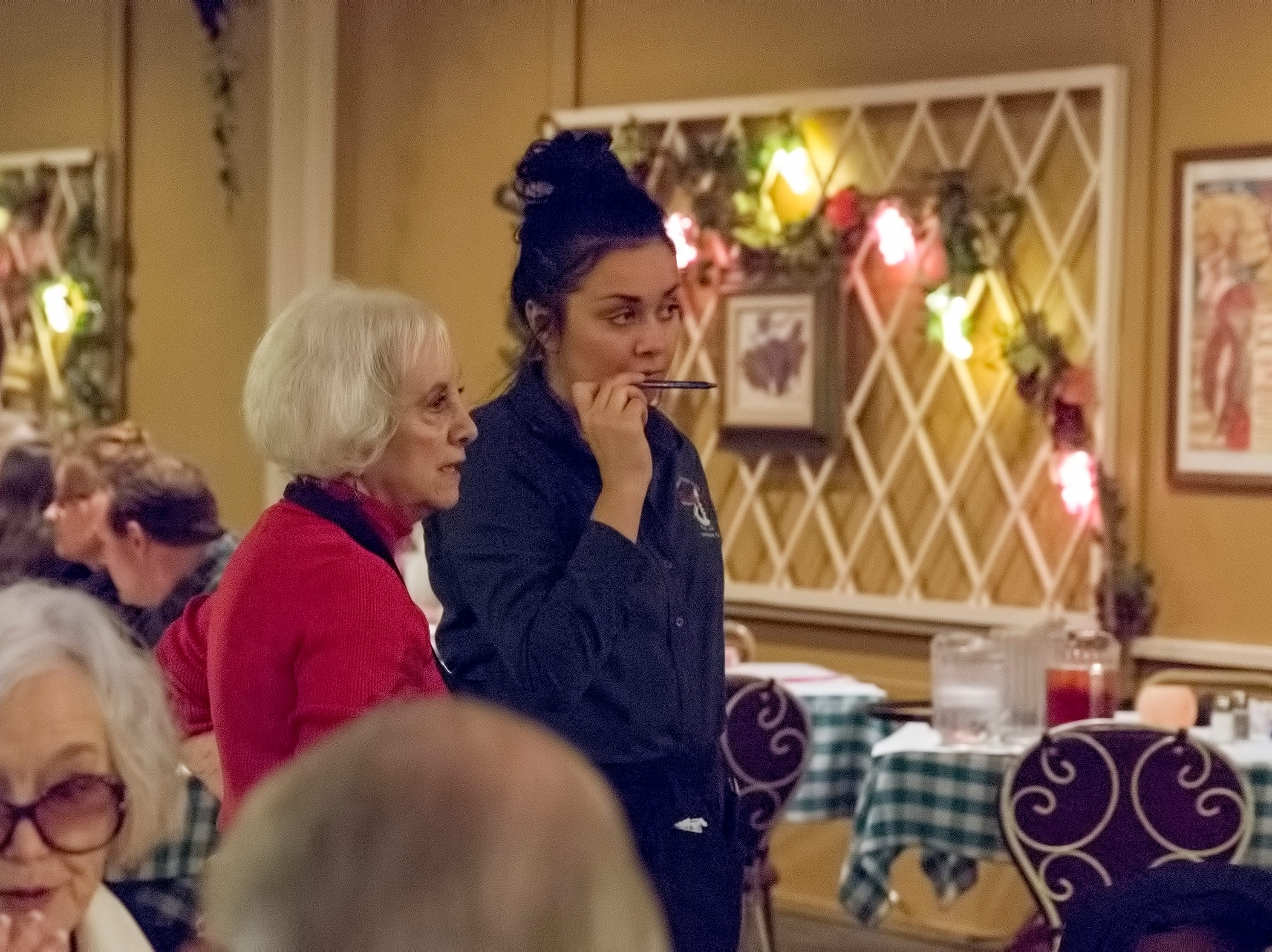 Baudo's owner, Sharon Baudo Smith, talks with one of the wait staff about diners at the last Wine Tasting Dinner Thursday evening, January 17, 2019.