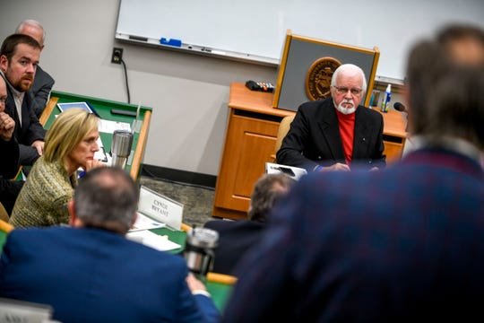 Gary Deaton listens to Mayor Jimmy Harris at a Madison County Commission meeting at West Tennessee AgResearch and Education Center in Jackson, Tenn., on Tuesday, Jan. 22, 2019.