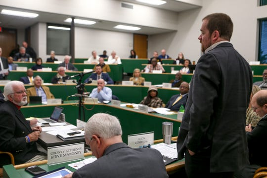 Jason Compton stands to speak at a Madison County Commission meeting at West Tennessee AgResearch and Education Center in Jackson, Tenn., on Tuesday, Jan. 22, 2019.