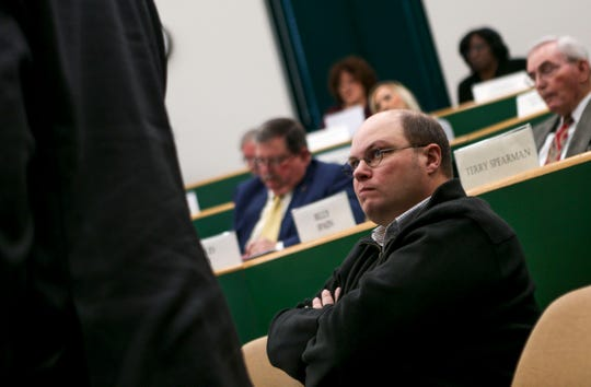 Jay Bush leans back and listens to Jason Compton speak to commissioners at a Madison County Commission meeting at West Tennessee AgResearch and Education Center in Jackson, Tenn., on Tuesday, Jan. 22, 2019.
