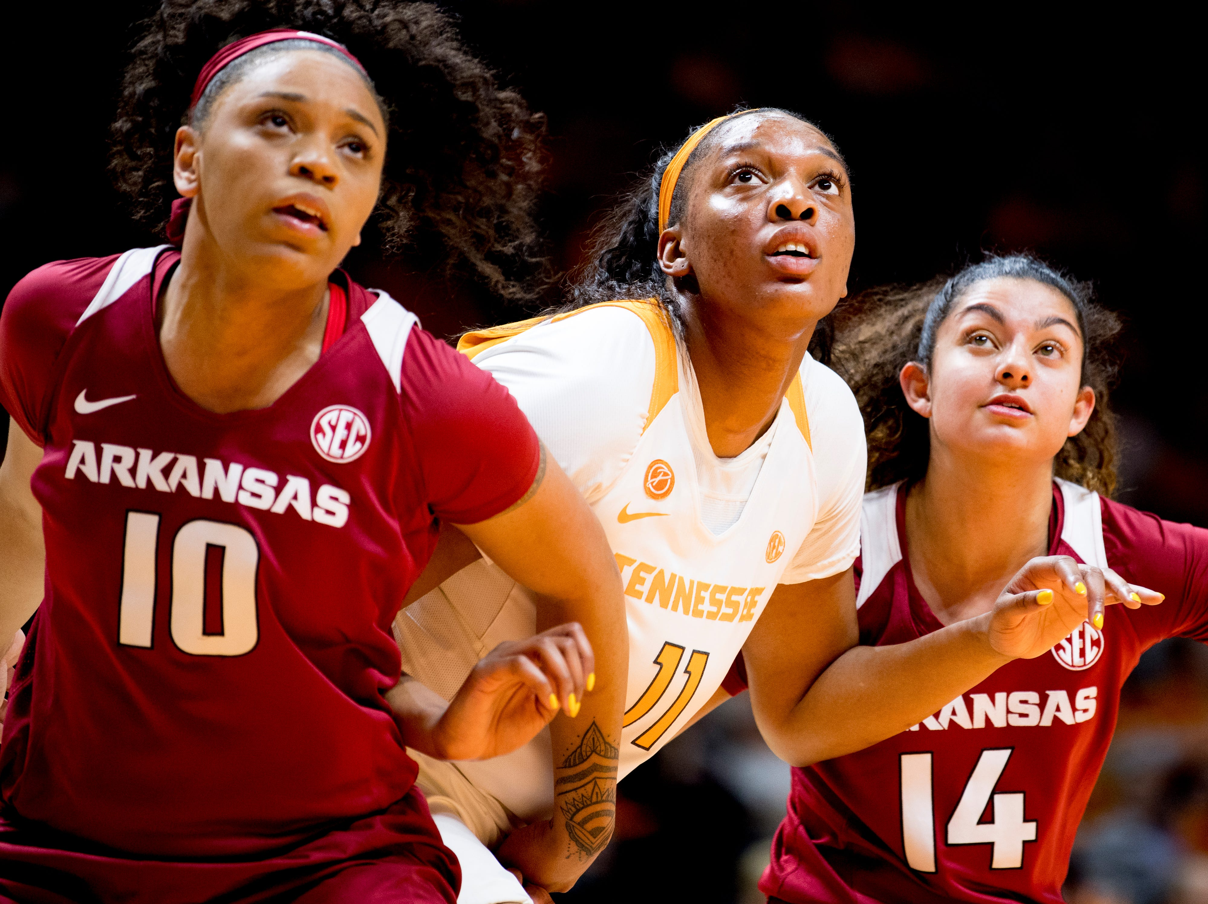 Tennessee center Kasiyahna Kushkituah (11) eyes the rebound with Arkansas forward/center Kiara Williams (10) and Arkansas point guard Jailyn Mason (14) during a game between Tennessee and Arkansas at Thompson-Boling Arena in , Tennessee on Monday, January 21, 2019.